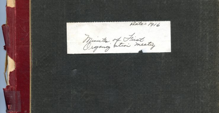 "Antique book with label that reads ""Minutes of First Organization Meeting"", ""Date=1916"""