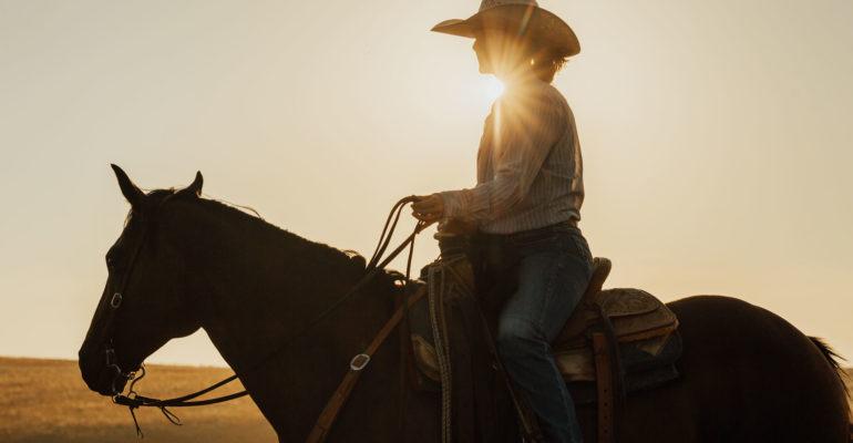 Woman rancher on horseback