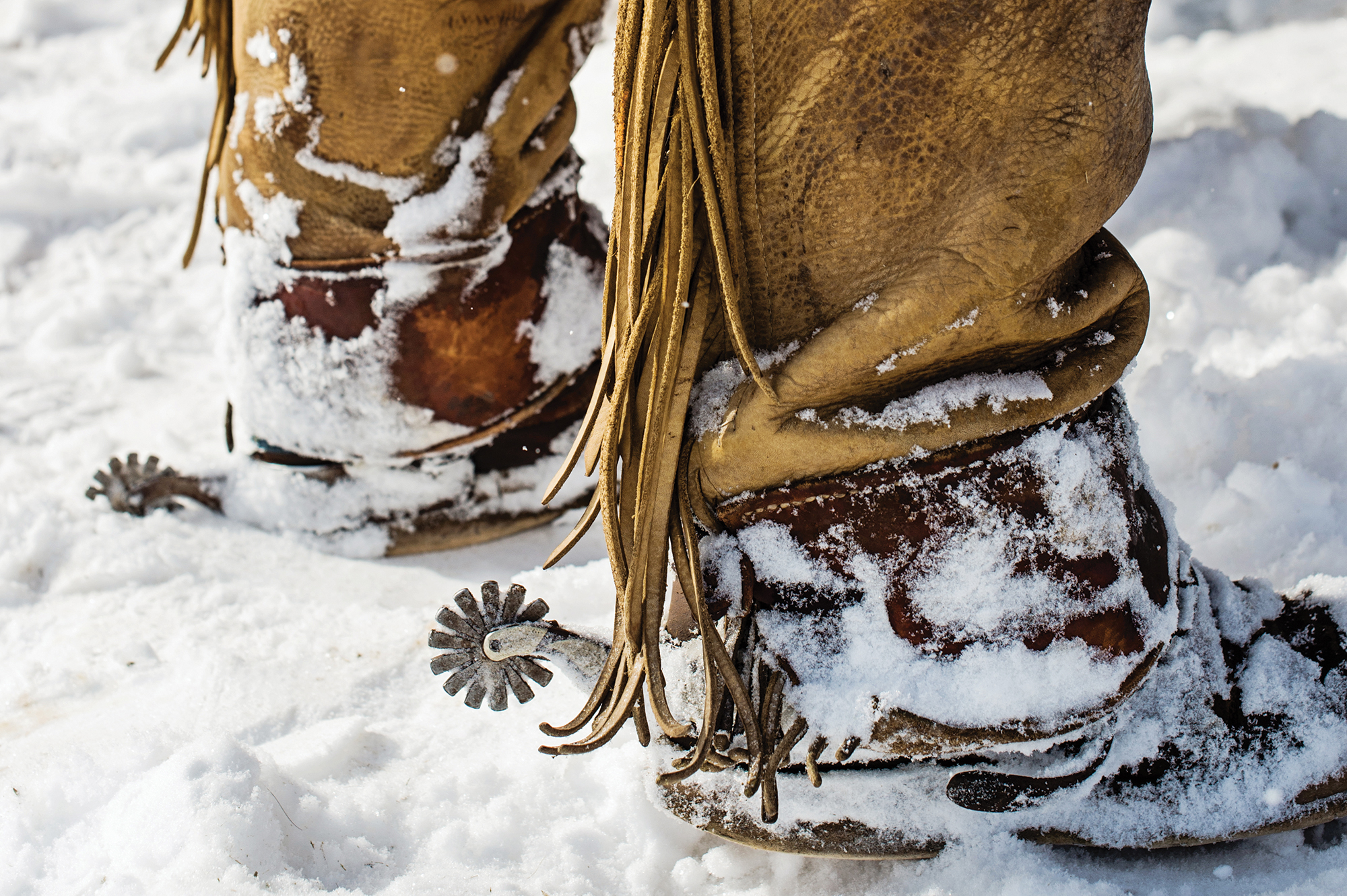 Close up of boots with spurs in the snow