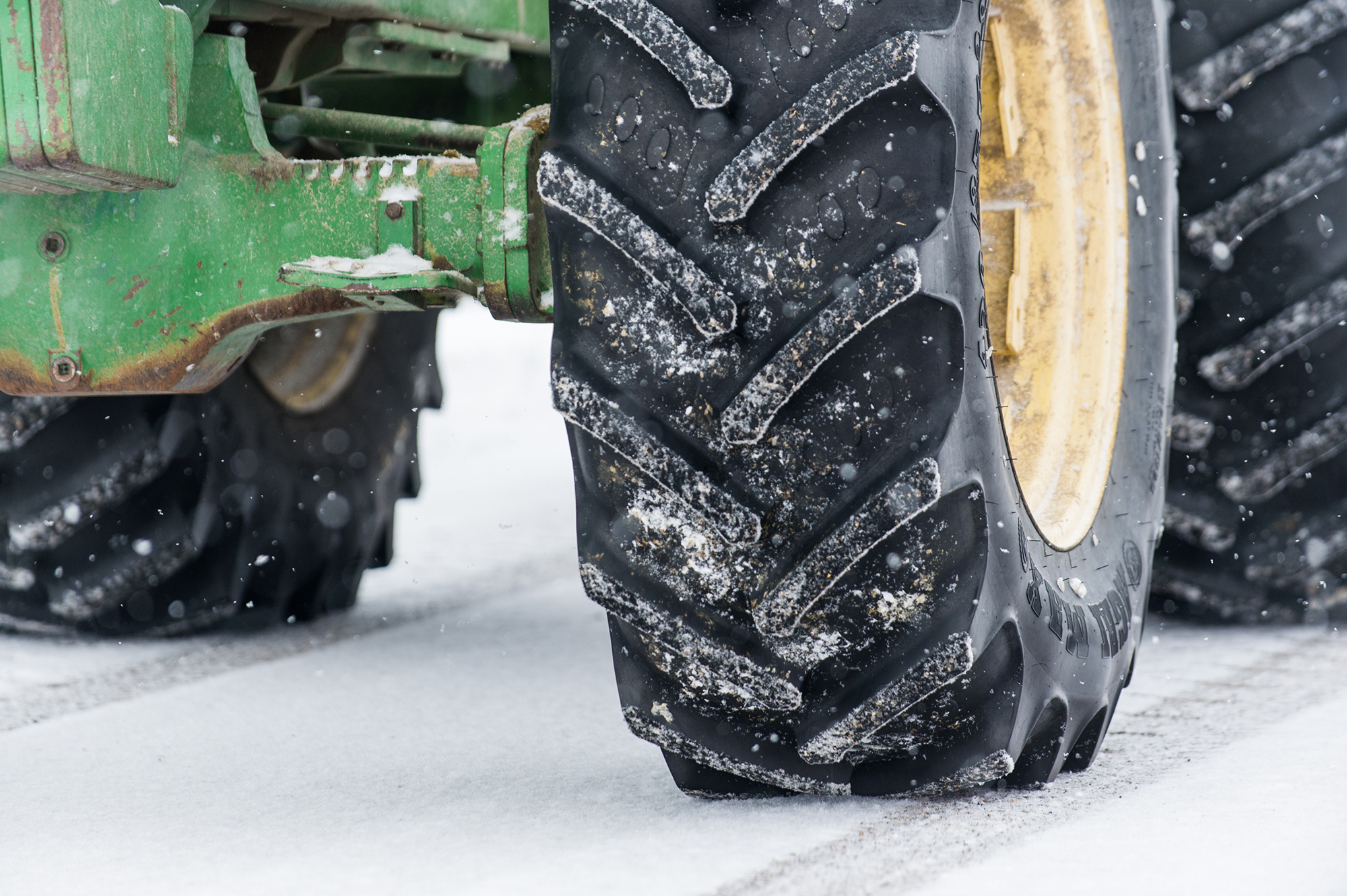 Close up of tractor tire in the snow