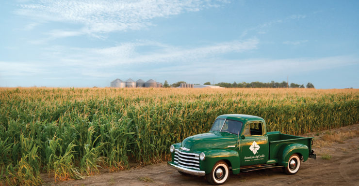 American AgCredit pickup truck in front of corn field