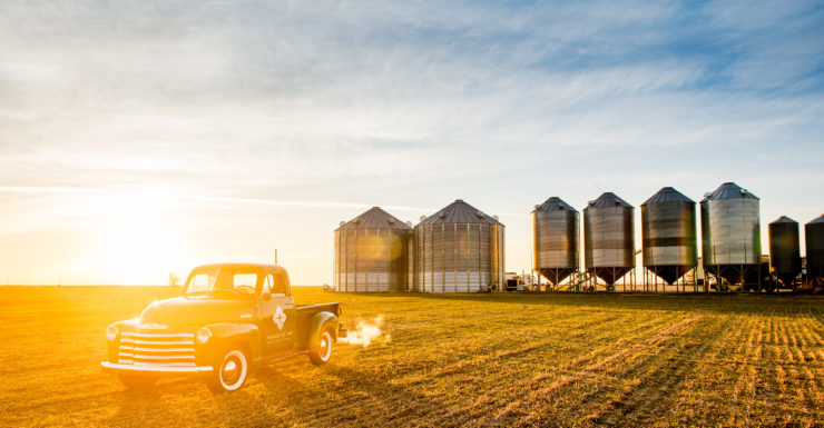American AgCredit truck in front of silos at sunset