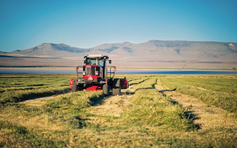 harvesting equipment in alfalfa field
