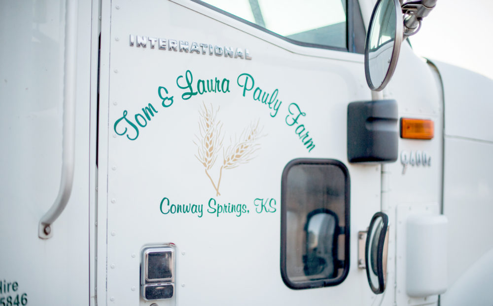 detail of Pauly Farm truck door with logo
