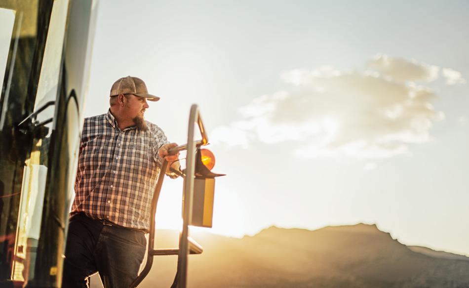 Jon Arreche on tractor at sunset